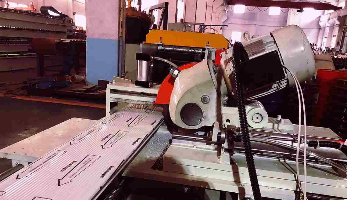 Garage door panel roll forming machines